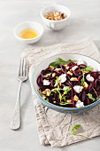 Raw spiralized beet salad with goat cheese and walnuts