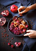 A smoothie bowl with beetroot chia pudding and quinoa muesli