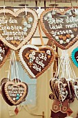 Gingerbread hearts hanging for sale at a market stand