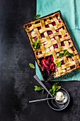 Sour cream and plum pie with a dough lattice