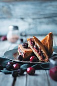 French toast with blackberries and cherries