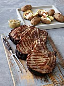 Grilled beef chops, onion puree, and grilled potatoes with bacon and sour cream