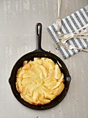 Grilled tarte tatin in a cast iron pan