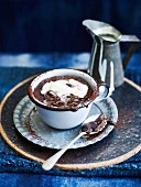Hot chocolate puddings with vanilla sauce