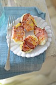 Eggs wrapped in bacon