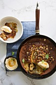 Banana clafoutis with honey and hazelnuts
