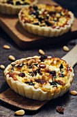 Spinach pie with sheep's cheese, raisins and pine nuts