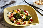 A vegetarian wok dish with broccoli, peppers, chili and cashews
