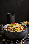 Wok vegetables with smoked tofu, mushrooms, and cashew nuts on rice (Asia)