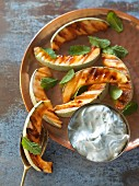 Grilled melon slices with goat's cheese