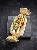 White asparagus in parchment paper