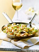 Pan fried gnocchi and leeks with prawns