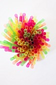 Colorful straws on a white background