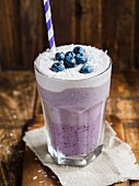 Vegan layered blueberry smoothie with coconut cream