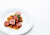 Veal fillet with caramelised tomato polenta, chanterelle mushrooms and apricots