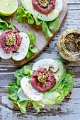 Open sandwiches with beef tartar, mustard, mushrooms, avocado and lettuce
