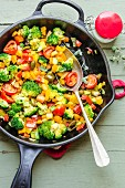 Colourful pan fried vegetables with turmeric