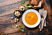 Pumpkin soup with sage and Croutons on wooden background
