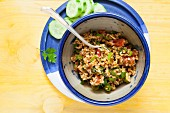 Bulgur wheat salad with onions, tomatoes, mint and pomegranate syrup