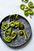 Fiddlehead ferns in a pan