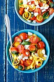 Tagliatelle with cherry tomatoes, basil and goats cheese