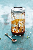 Mango and barbecue sauce in a glass jar
