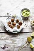 Quinoa and carrot balls with a lime and avocado dip