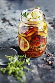 Sweet and sour pickled courgettes in a glass jar