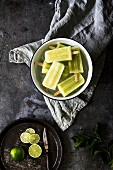 Homemade ice lollies with cucumber and lime