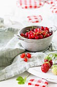 Currants and strawberries in a preserving bowl