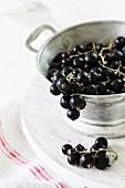Blackcurrants in a colander