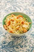 Pasta with salmon, fresh cheese, lemon zest and parmesan