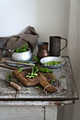 Peas on a rustic wooden table