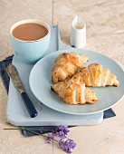 Croissants with almond flakes, served with tea