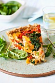 A piece of spinach and sweet potato quiche