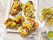 Orange and fennel salad with spicy salami slices on ciabatta bread