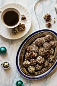Dates and almond truffles, no sugar, cup of coffee, Christmas decorations