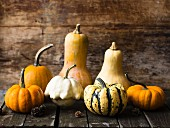 Various pumpkins on a wooden surface