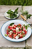 Salad with watermelon, strawberries, mint and zaatar labneh