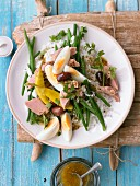 Nicoise salad with tuna, eggs, green beans, and rice
