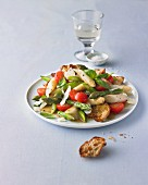 Asparagus salad with cherry tomatoes, toasted bread and basil