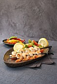 Prawn skewers with pepper salsa and avocado salad