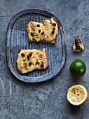 Lemon curd with caramelised lime peel, almonds and pomegranate seeds on toast bread