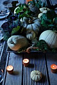 Autumn centrepiece with pumpkins, cabbages and candles