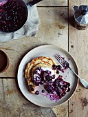 Pancakes with blueberries, plain yoghurt, honey and pumpkin seeds