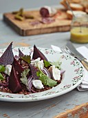 Puy lentil salad with beetroot and soft goat's cheese on a plate