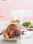 A lamb roast with asparagus, broccoli and potatoes for Easter