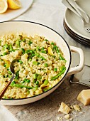 White risotto with sugar snaps, peas and thin sliced asparagus