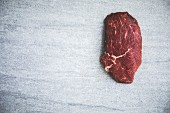 A free-range organic raw beef steak (seen from above)