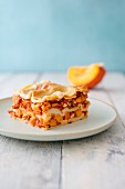 A slice of vegan pumpkin lasagne with tofu and almond and bechamel sauce